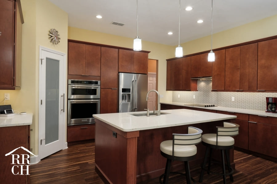 Eat-In Kitchen with Built-In Appliances and Modern Cabinet Fixtures | Robinson Renovations and Custom Homes