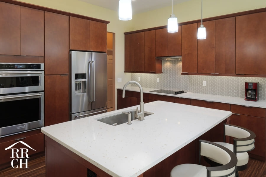 Kitchen Remodel with Contemporary Stools and Eat-In Island and Built-In Appliances | Robinson Renovations and Custom Homes