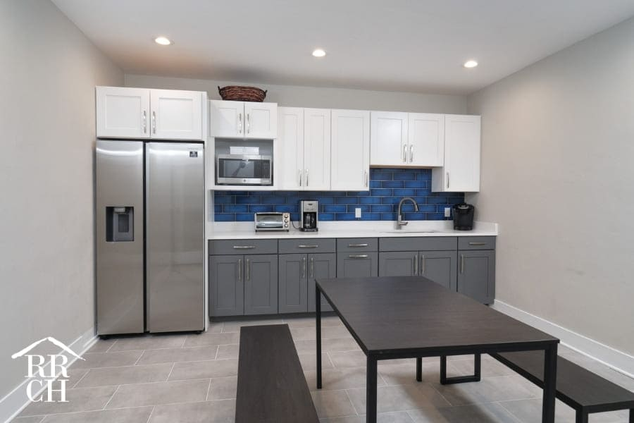 Beautiful Staff Kitchen with Grey and White Cabinets Inside Commercial Office Building Renovation Project | Robinson Renovation and Custom Homes