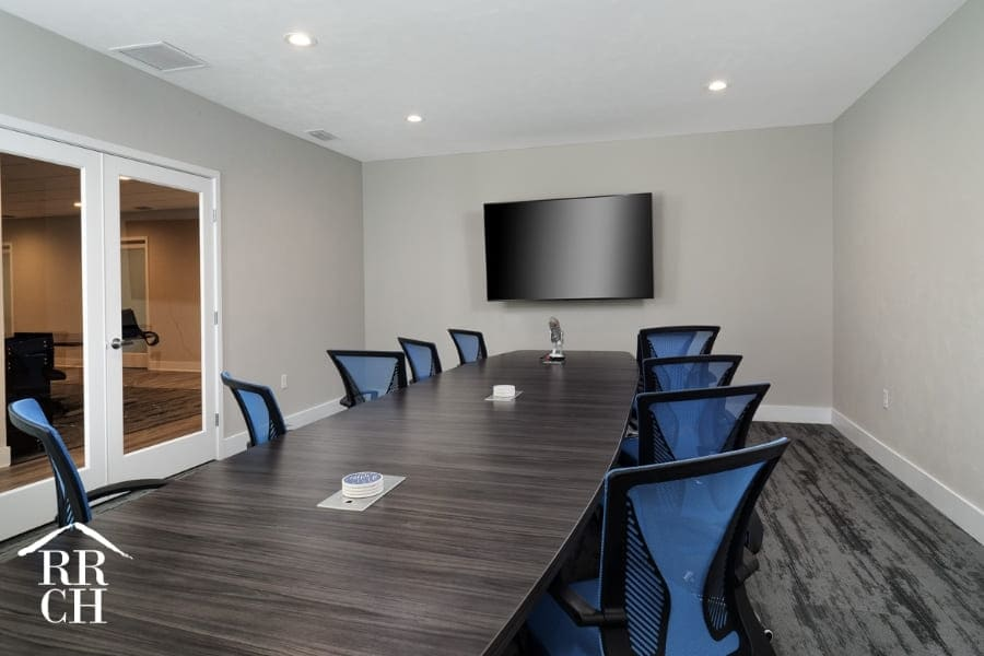 Board Room Inside Commercial Office Renovation Project with Recessed Lighting and Corporate Friendly Carpeting | Robinson Renovation and Custom Homes