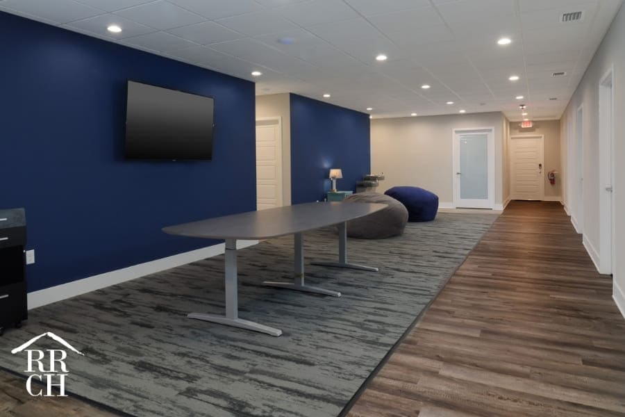 Office Remodel Commercial Renovation Project with Blue Accent Walls and Hardwood Flooring and Carpeted Area | Robinson Renovation and Custom Homes