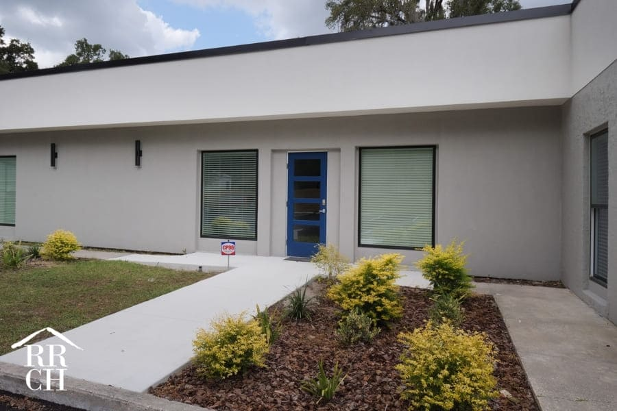 Office Renovation Modern White Exterior with Black Trim and Plant Bed | Robinson Renovation and Custom Homes