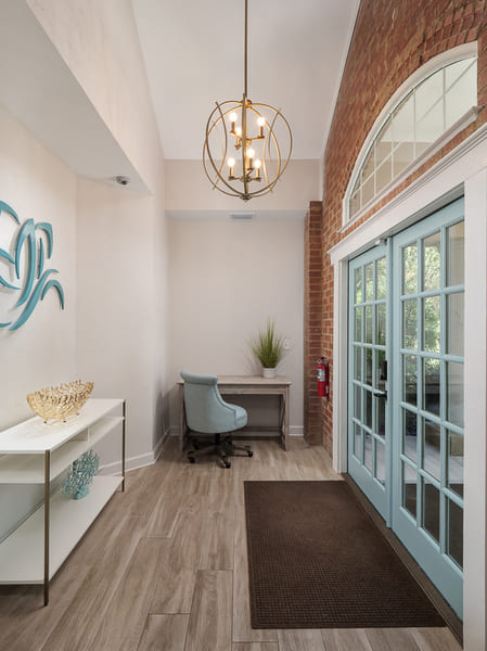 Dentist Office Commercial Renovation Front Entrance with Overhead Geometric Lighting Fixture in Florida by Robinson Renovation & Custom Homes