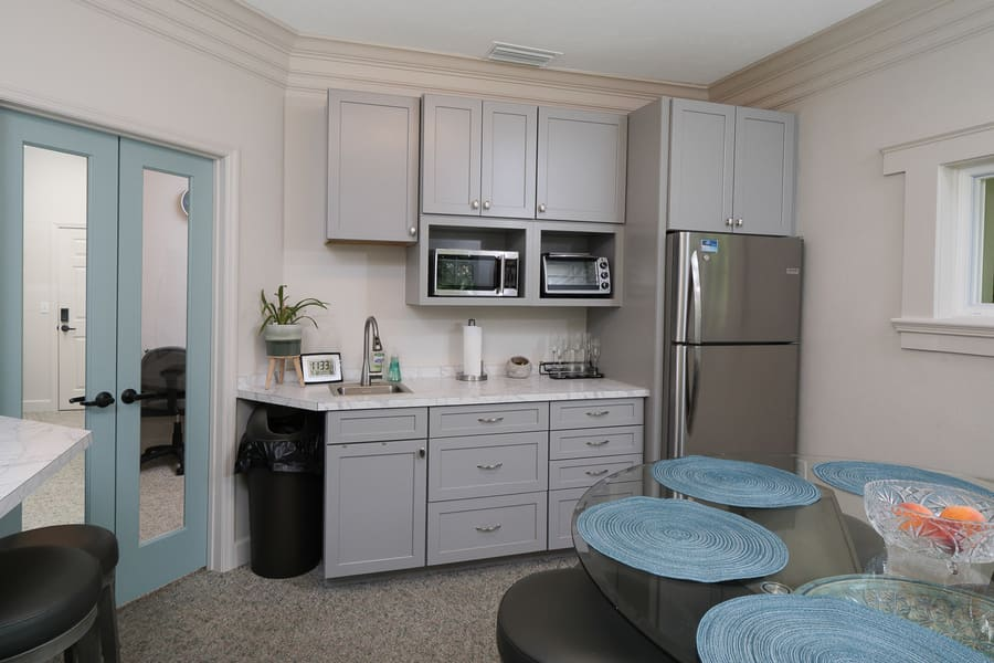 Dentist Office Commercial Renovation Staff Kitchen with Shaker Cabinetryin Florida by Robinson Renovation & Custom Homes