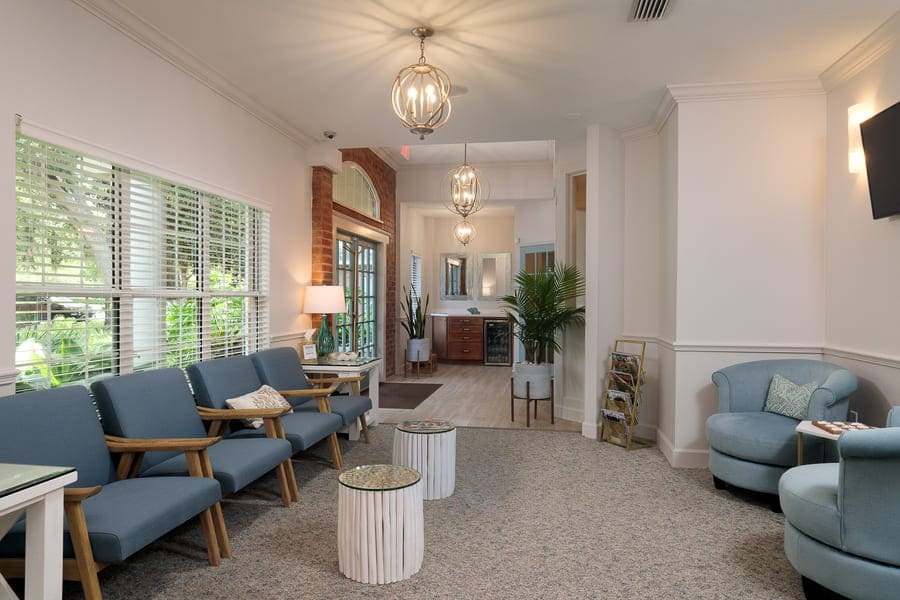 Dentist Office Commercial Renovation Waiting Area with Geometric Lighting and Entryway in Florida by Robinson Renovation & Custom Homes
